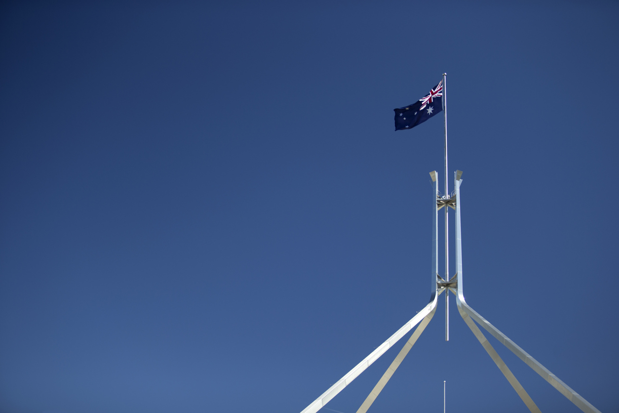 Australian Flag flying above Parliament House