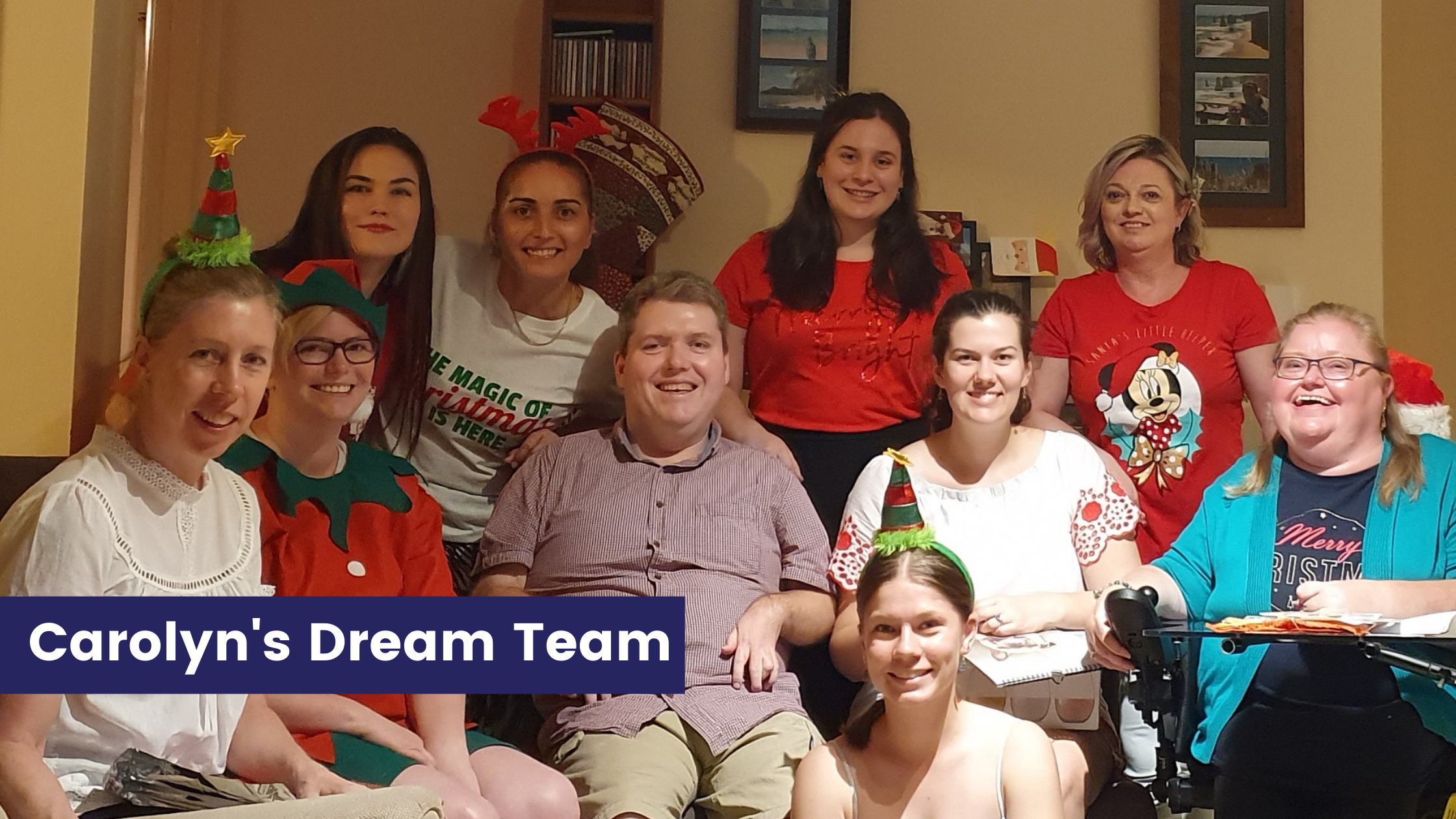 Carolyns  Dream Team - Carolyn and her partner surrounded by 8 people in Christmas costumes
