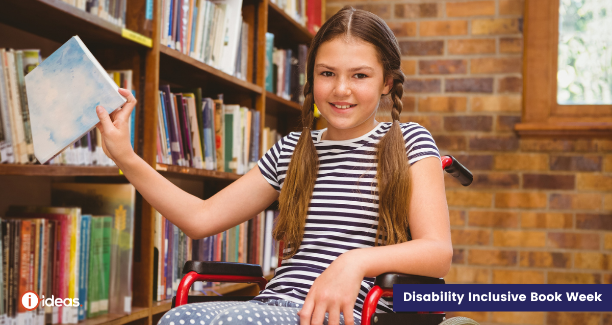 Young girl getting a book from a library shelf - she is using a wheelchair