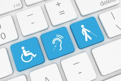 3 blue keys on a keyboard. Each key has a symbol for accessibility. From left to right: Wheelchair access. Hearing loop and a person with low vision using a cane.