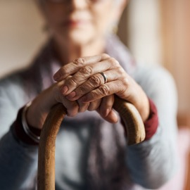 Image of older woman with cane