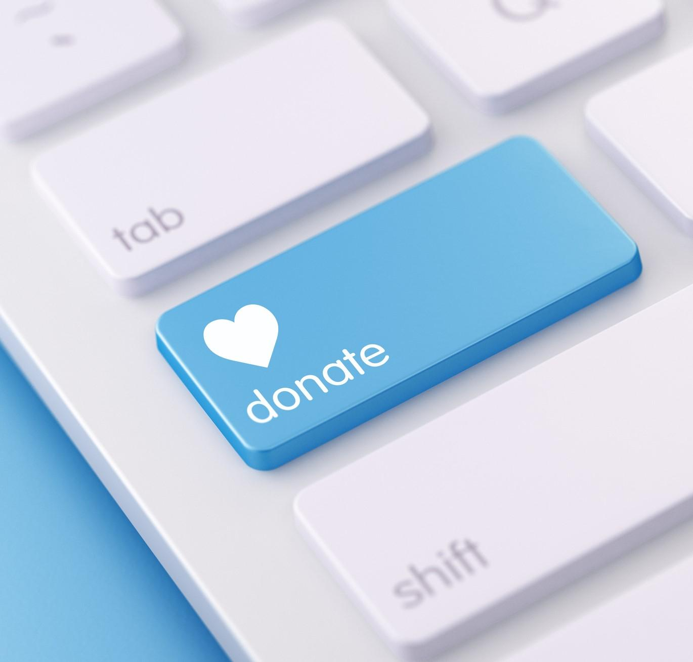 Bright blue Donate button with heart symbol on keyboard