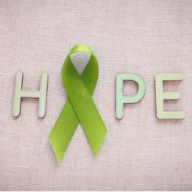 Image of lime green ribbon with letters H, P and E. Spells