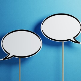 Image of white speech bubbles on a blue background