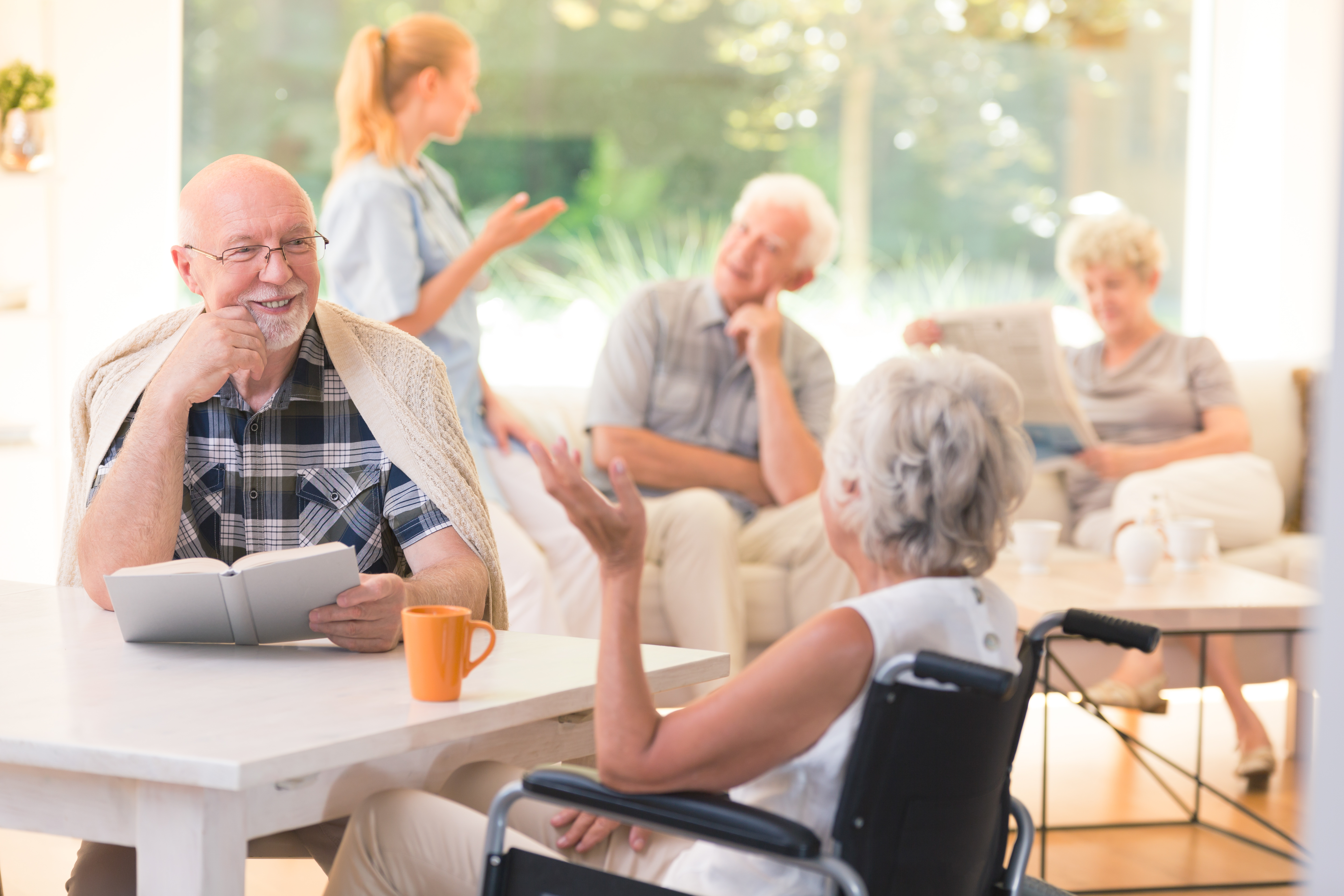 2018.12.04 Stock Photo Inside Retirement Home Happy elderly people being social and having a conversation 001