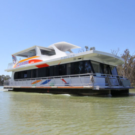 Image of a Houseboat on the water viewed from side on