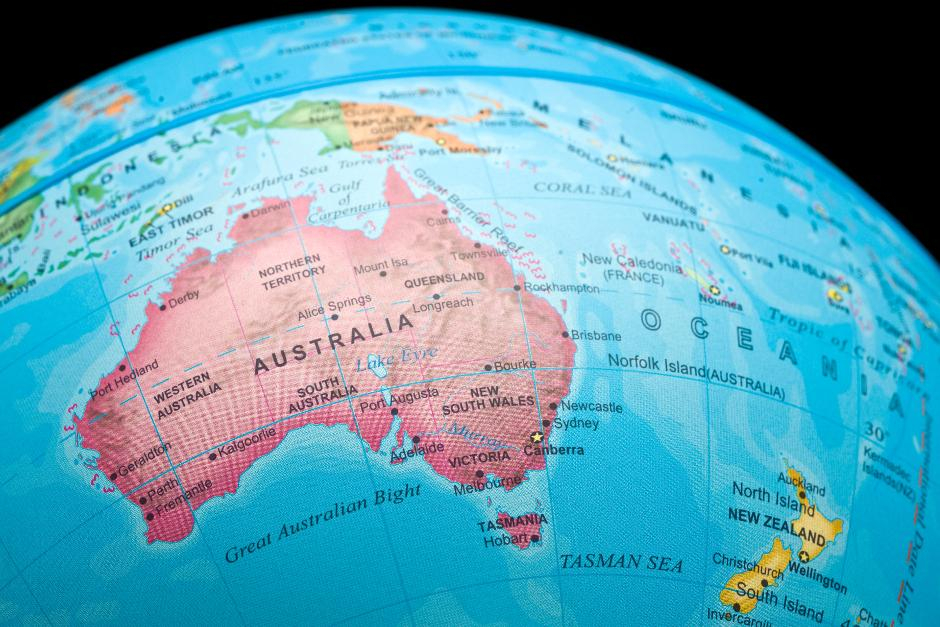 An image of a portion of a world globe showing a map of Australia in Pink
