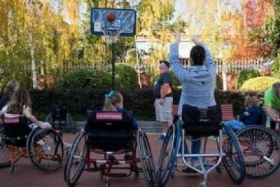 Group of people playing wheelchair basketball