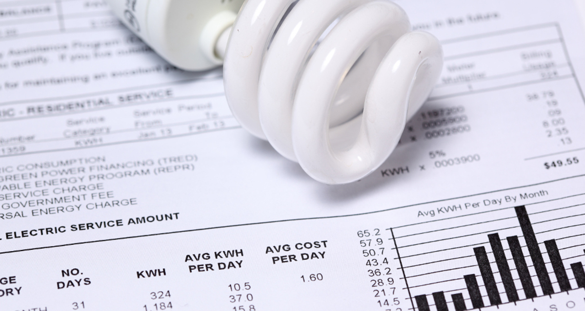 An image of a lightbulb laying on a utility bill