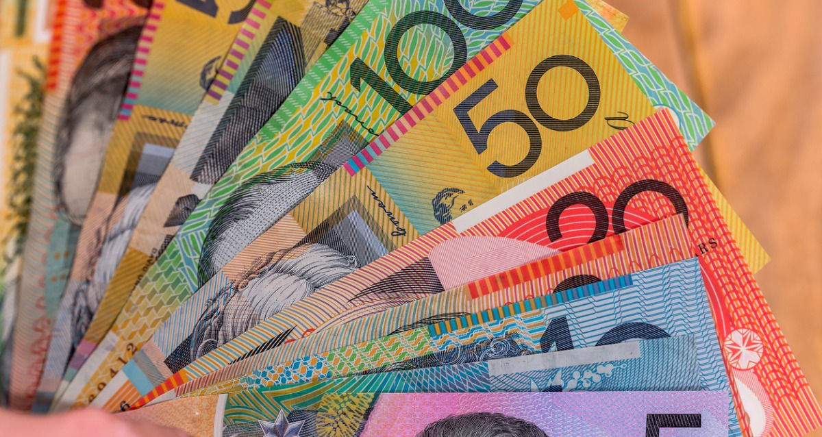 Image of australian-dollars-in-fan-on-wooden-desk-picture