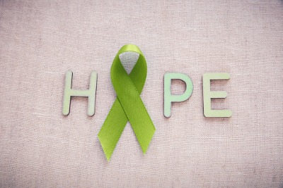 Hope spelled out with a green ribbon as the o