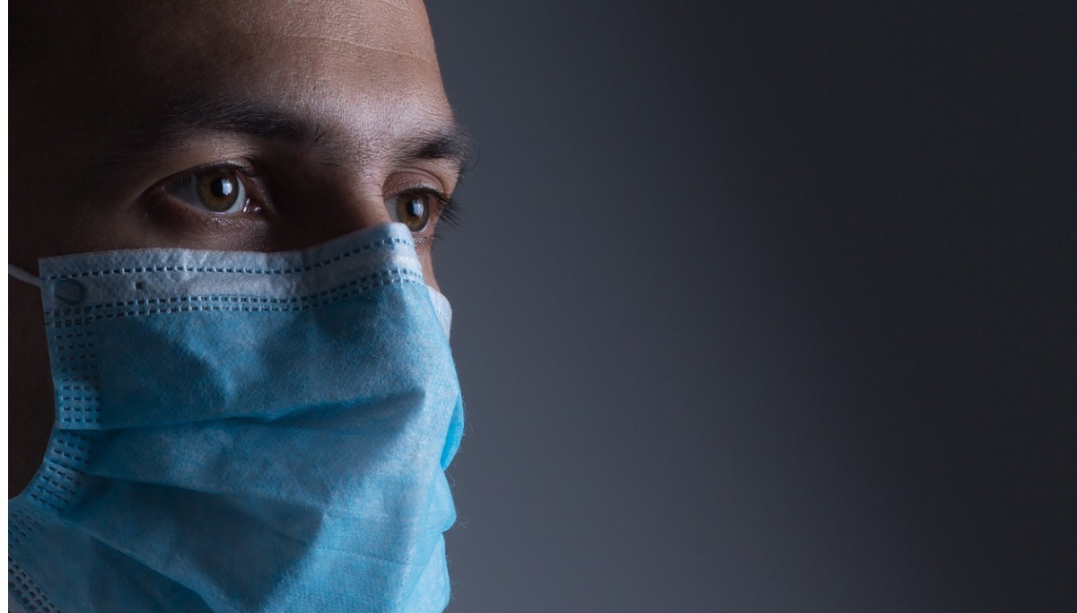 man wearing a surgical face mask