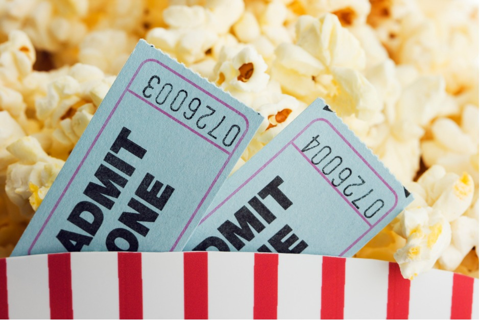 Image of popcorn and two movie tickets
