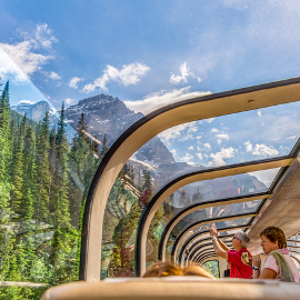 mountain range viewed through glass roof of train