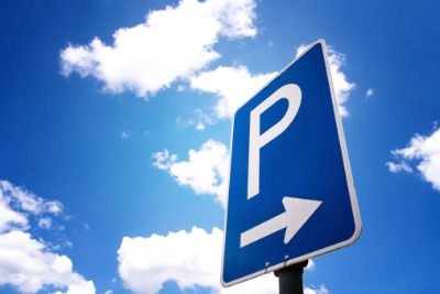 Blue sky with white clouds, a parking sign