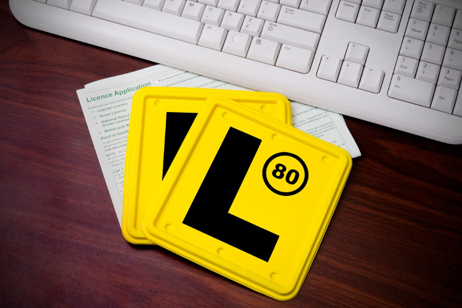 "Two yellow ""L"" learner plates"