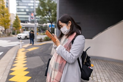 pregnant woman on street wearing medical mask