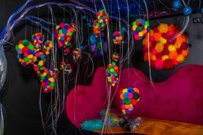 Image of a sensory room with tactile chair and hanging objects