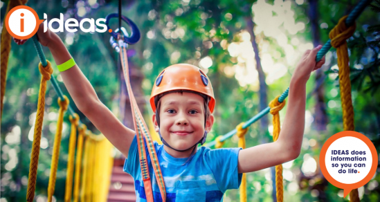 Image of boy wearing helmet on rope course