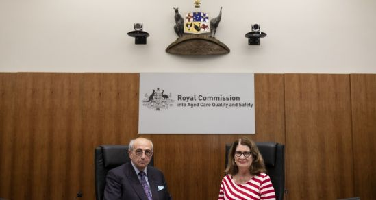 Hon Gaetano Pagone QC  and Lynelle Briggs AO at the Bench of the Royal Commission into Aged Care Quality and Safety