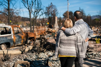A couple checking ruins after a fire disaster