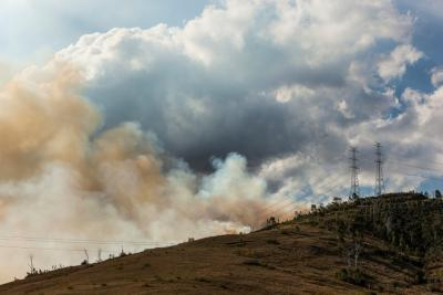 Image of bushfire smoke with power lines on the hill