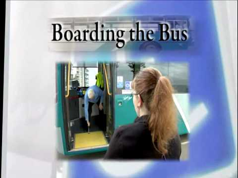 Boarding the bus and a lady in a wheelchair ready to board a bus