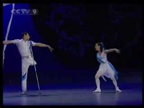 Man without a leg and woman without an arm on stage performing ballet