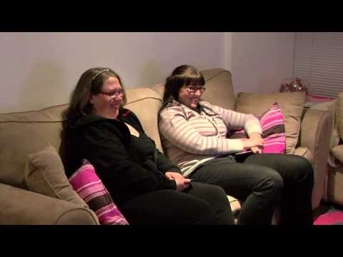 2 ladies sitting on the lounge laughing