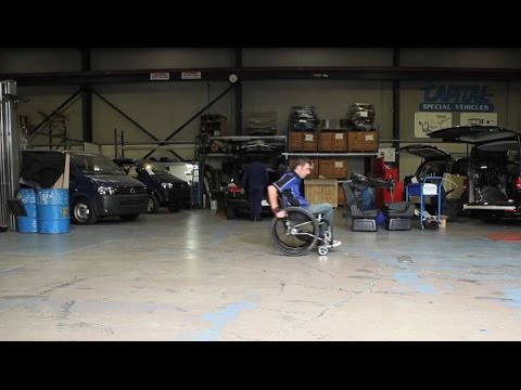 Man in a wheelchair in a workshop
