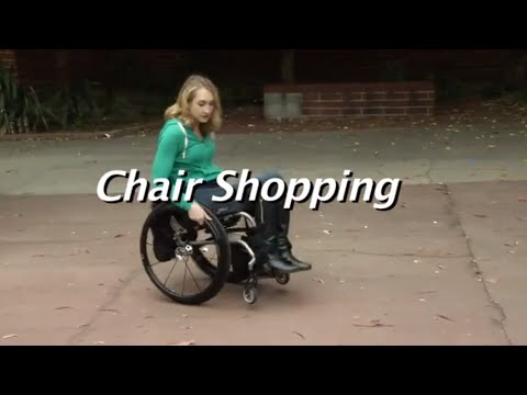 Lady on sidewalk in wheelchair