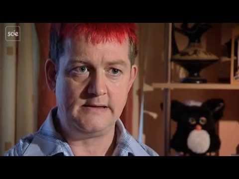 Man with red hair sitting and talking