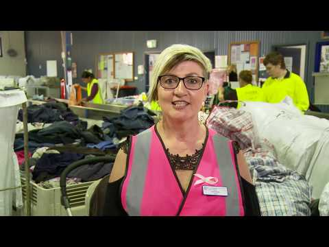 Lady in pink hi vis top in a factory