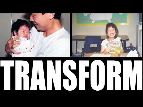 Man holding a new born baby and the word transform written across the bottem
