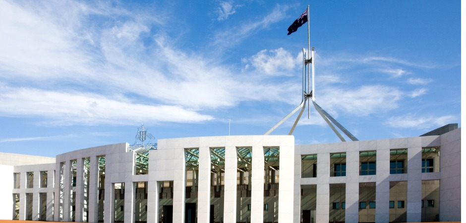 Exterior shot of Parliament House, Canberra with Australian Flag flying above