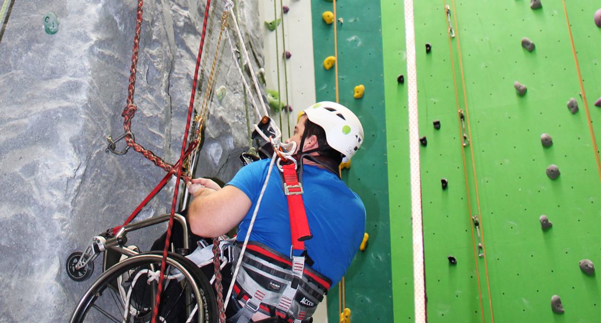 person participating in adaptive rock climbing
