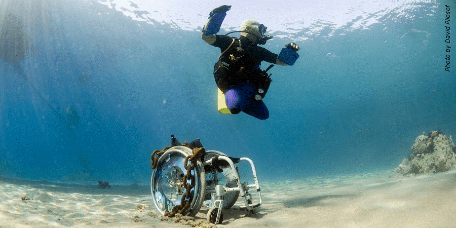 Person with a disability participating in adaptive scuba diving