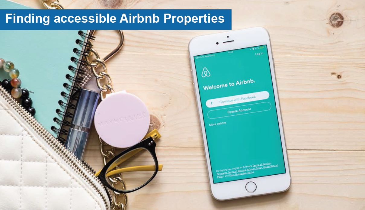 Finding accessible properties. A mobile phone with the Airbnb app open.