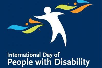 International day of people with disability logo, human figure with coloured filigrees and text
