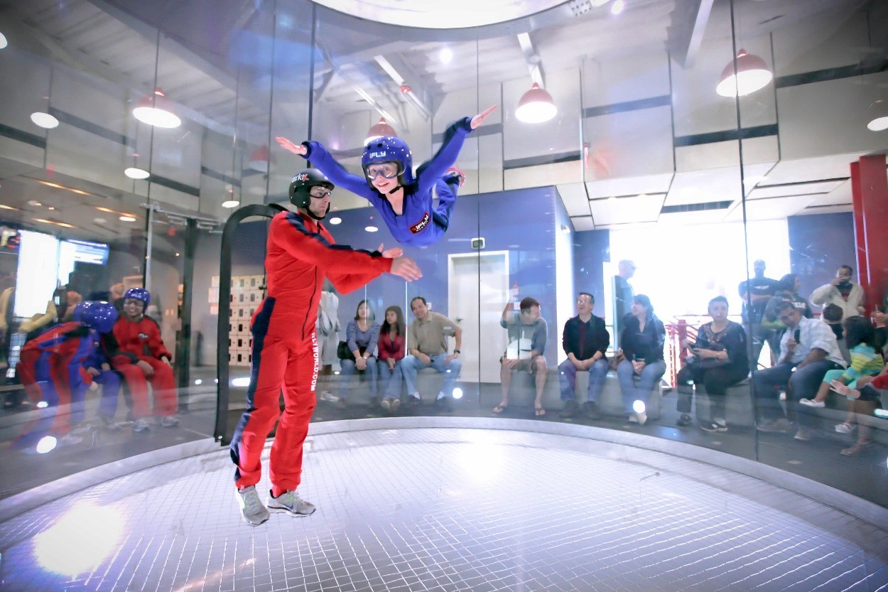 A person participating in indoor skydiving