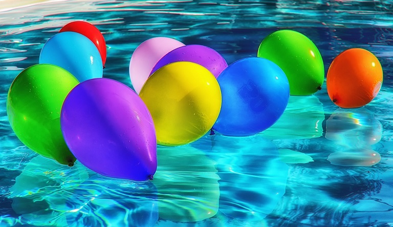 Coloured Balloons in a Swimming Pool