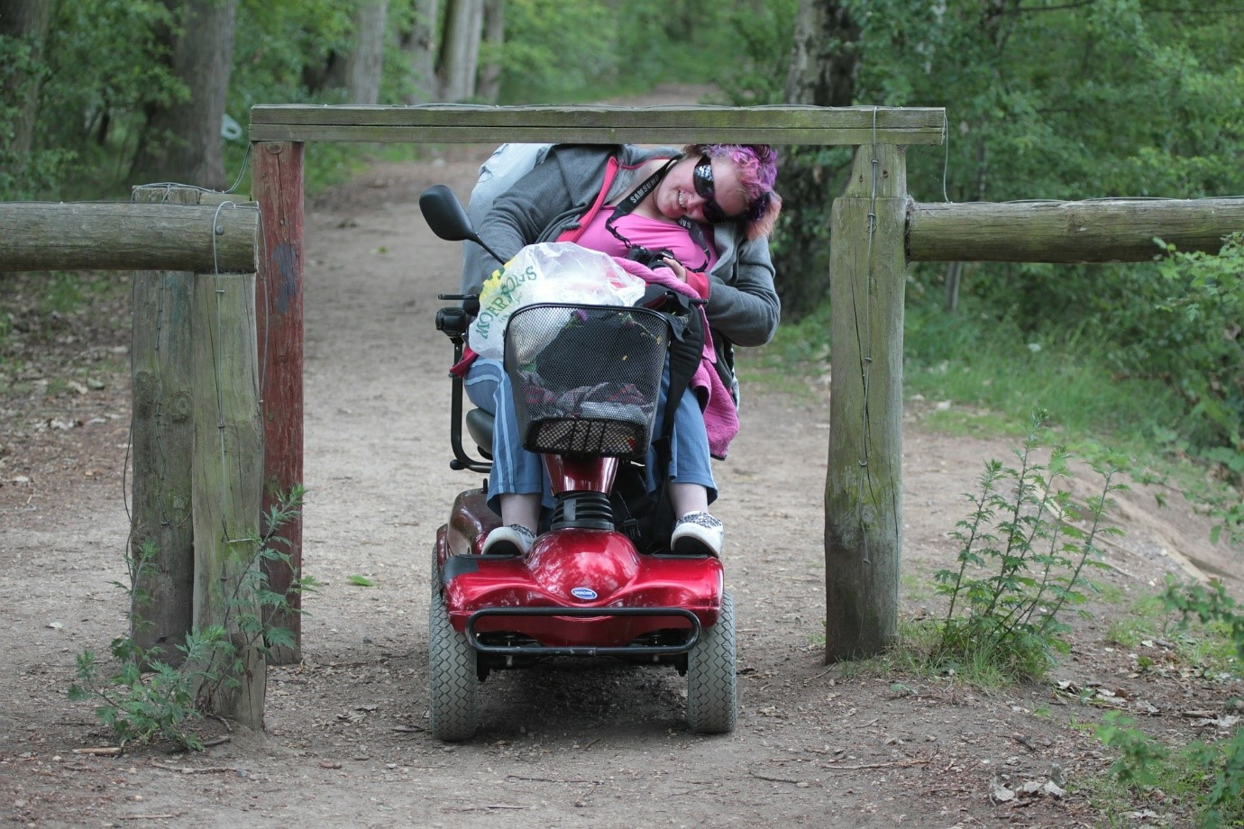 Lady travels on electric scooter on a bush trail