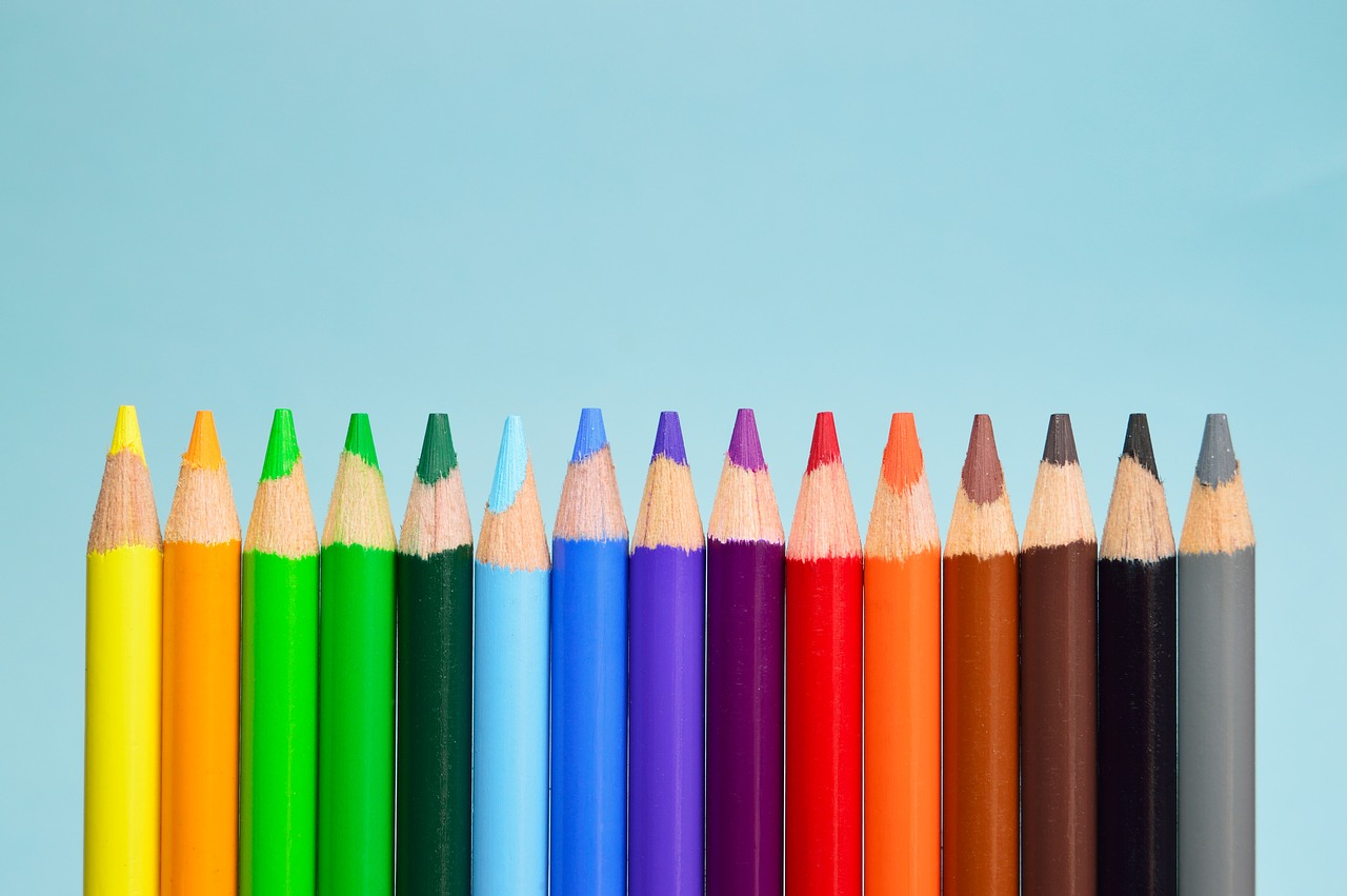 Row of coloured pencils going from yellow to grey