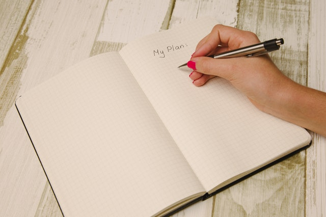 "blank book with hand writing ""My Plan"" on it"