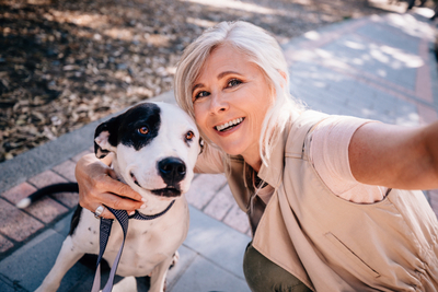 Image of a selfie of a lady and a dog